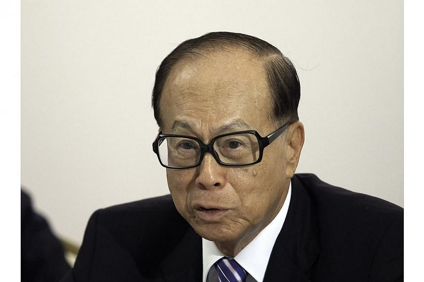 Mr Li Ka-shing, chairman of Cheung Kong (Holdings), speaks during a news conference after the company's annual general meeting in Hong Kong, China, on Friday, May 20, 2011. A company controlled by Mr Li has sold a landmark Beijing property for m