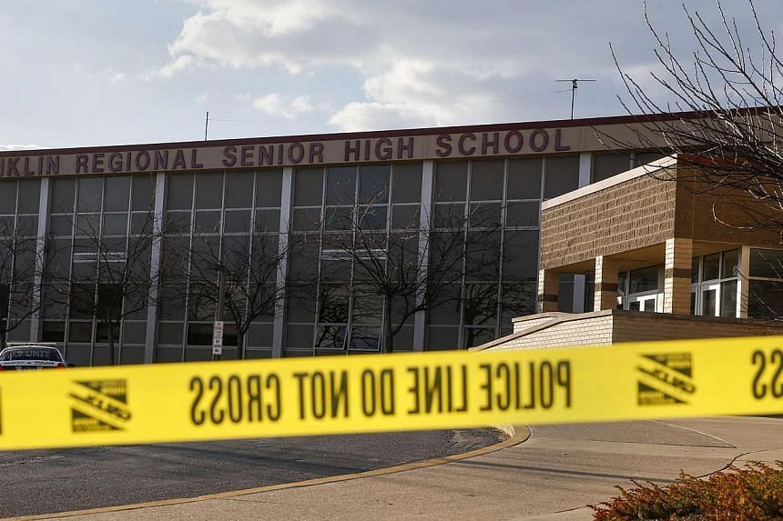 Police tape is seen outside Franklin Regional High School after a series of knife attacks in Murrysville, Pennsylvania April 9, 2014. -- PHOTO: REUTERS