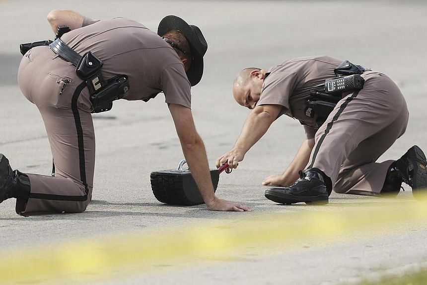 Highway Patrol officers investigate tire skid marks after a car struck the KinderCare Learning Center in Winter Park, Florida on April 9, 2014. -- PHOTO: REUTERS