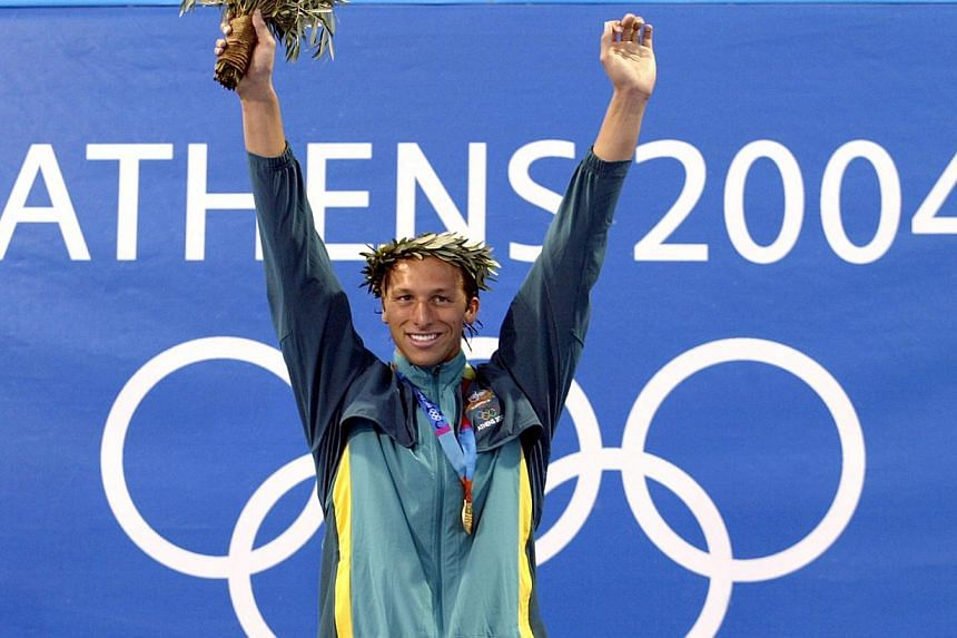 Ian Thorpe celebrates on the podium after winning the men's 200m freestyle gold medal, at the 2004 Olympic Games at the Olympic Aquatic Centre in Athens on Aug 16, 2004. -- FILE PHOTO: AFP