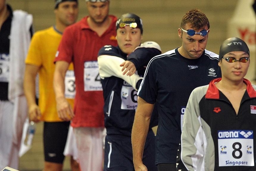 Australian swimmer Ian Thorpe (second from right) at the Fina/Arena Swimming World Cup final on Nov 4, 2011. -- ST FILE PHOTO: DESMOND WEE