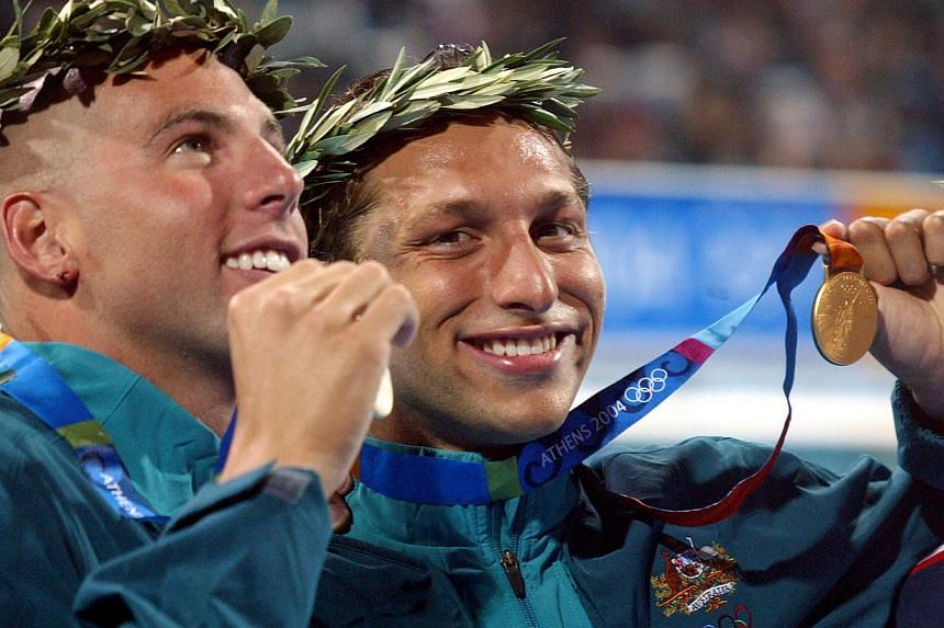 Australian swimmers Grant Hackett (left) and Ian Thorpe (right) with their medals after the 400m freestyle final at the 2004 Olympic Games in Athens on Aug 14, 2004. -- FILE PHOTO: AFP