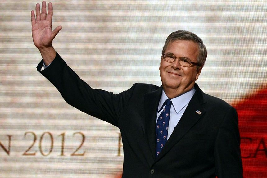 Former Florida Governor Jeb Bush waving to the audience on the final day of the Republican National Convention (RNC) at the Tampa Bay Times Forum in Tampa, Florida on Aug 30, 2012. -- FILE PHOTO: AFP