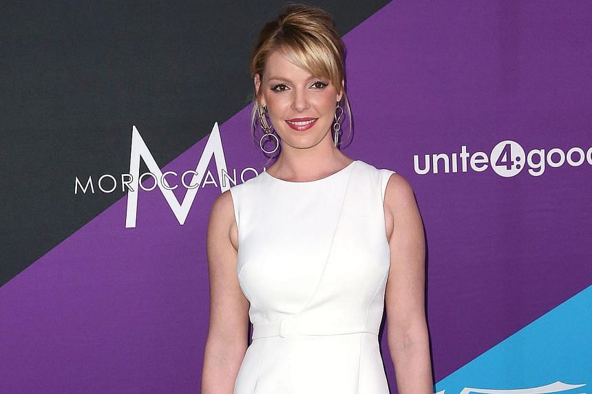 Actress Katherine Heigl has filed a US$6 million (S$7.5 million) civil lawsuit against New York pharmacy Duane Reade for using her name and an unauthorised paparazzi photograph of her in its commercial advertising. -- FILE PHOTO: AFP
