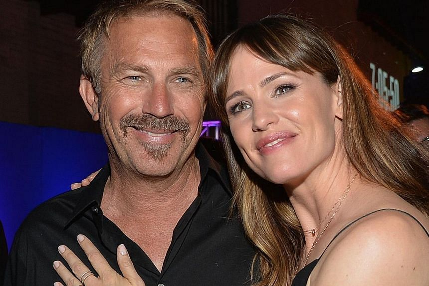 Kevin Costner and Jennifer Garner at the after party for their film Draft Day on April 7, 2014 in Los Angeles. -- FILE PHOTO: AFP