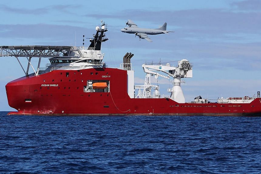 A Royal Australian Air Force AP-3C Orion flying past Australian Defence Vessel Ocean Shield on a mission to drop sonar buoys to assist in the acoustic search for MH370 in the southern Indian Ocean on April 9, 2014. -- PHOTO: AFP