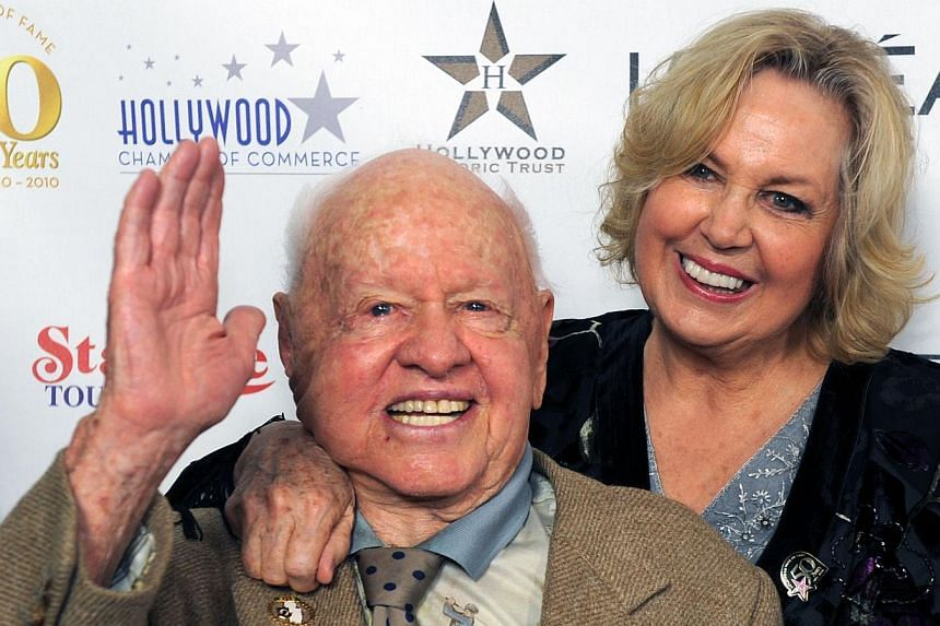 United States actor Mickey Rooney and then his wife Janice posing when arriving for the 50th anniversary birthday for the Hollywood Walk of Fame on Nov 3, 2010. -- PHOTO: AFP