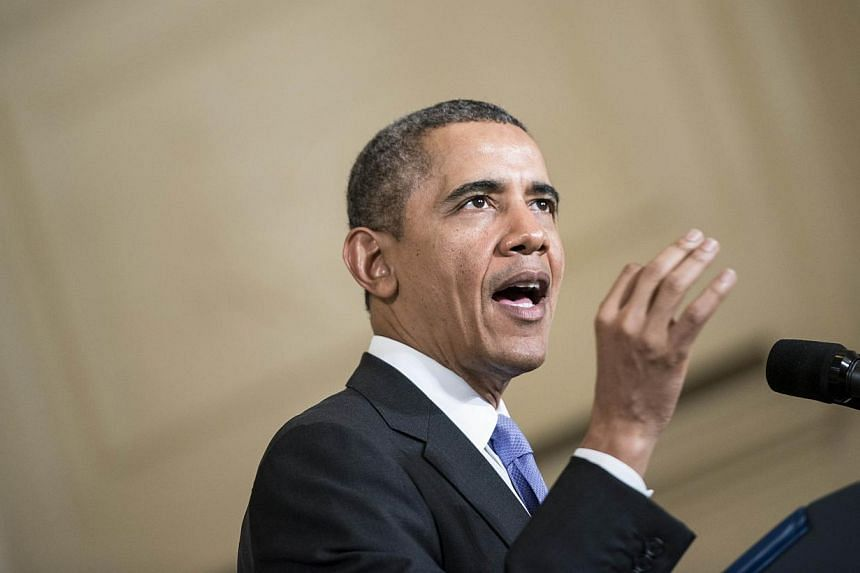 Mr Obama blasted Republicans in the US Senate for blocking a Democratic-supported Bill earlier in the day aimed at addressing a gap in pay between male and female workers. -- PHOTO: AFP