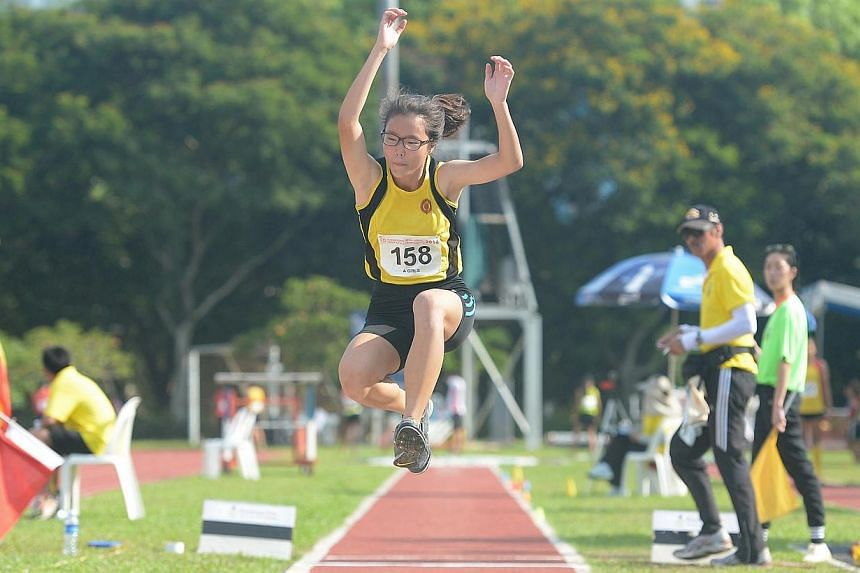 Lynette Lim of Victoria Junior College set a new national triple jump record on Thursday, April 10, 2014, setting an 11.89m mark at the Schools National Track and Field Championships A Division final at Choa Chu Kang Stadium. -- ST PHOTO: NG SOR