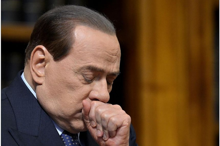 Former Italian prime minister Silvio Berlusconi reacting during a press conference at the senate in Rome on March 25, 2012. Italy's Silvio Berlusconi braced for a humiliating court hearing on Thursday, April 10, 2014, that will result in the thr