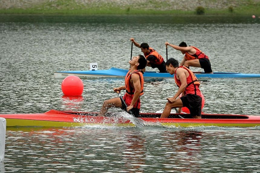Chan Jun Yang and Joel Lee of Hwa Chong Institution (HCI) as they crossed the finishing line in the A division boys 500m event.HCI retained their A Division boys' and girls' titles at the Schools National Canoeing Championships yesterday, seein