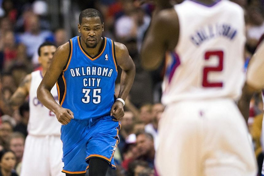 Oklahoma City Thunder forward Kevin Durant (35) reacts after scoring against the Los Angeles Clippers during the third quarter at Staples Center.Russell Westbrook scored 30 points, grabbed 11 rebounds and dished out six assists, and the Oklahom
