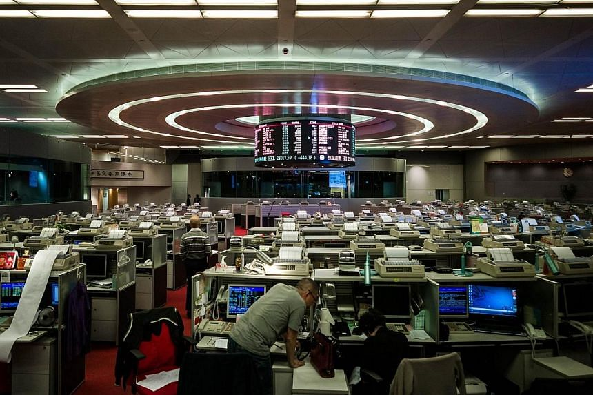 A trader is seen at the stock exchange in Hong Kong on Thursday, April 10, 2014.China's securities regulator and its Hong Kong counterpart said on Thursday they would allow mainland investors to trade shares in designated companies listed in Ho