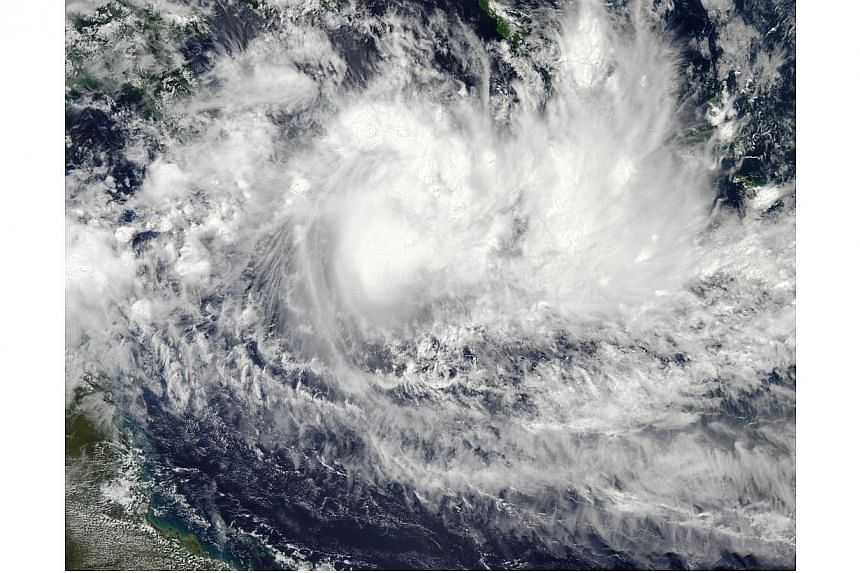 This April 8, 2014 NASA Aqua satellite image shows Tropical Cyclone Ita churning off the coast of Australia.Australia's sparsely populated northern tip was on Thursday, April 10, 2014, preparing for the largest cyclone to hit the area since Cyc