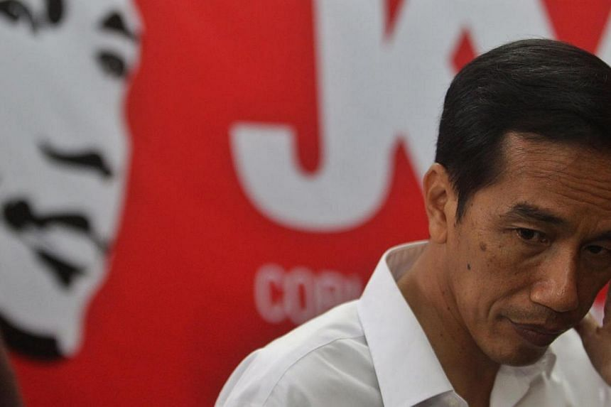 Jakarta governor and PDI-P presidential candidate Joko Widodo during a press conference in Jakarta, Indonesia, on 9 April 2014. An unexpectedly weak election result for the party behind the frontrunner to be Indonesia's next president hurt stock