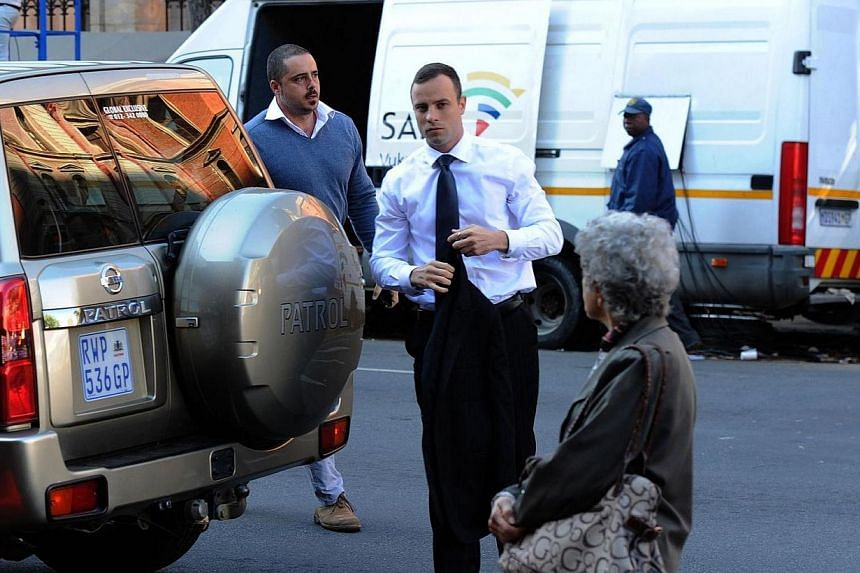 South African paralympic athlete and murder-accused Oscar Pistorius arrives at the high court in Pretoria prior to a hearing of his trial on Thursday, April 10, 2014. Under pummelling cross-examination, Oscar Pistorius admitted on Thursday that