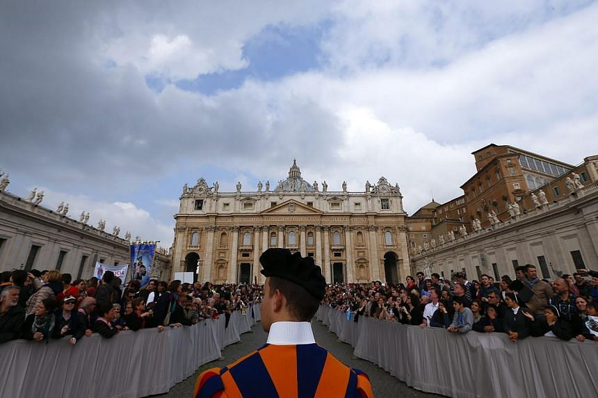 A Swiss guard stands for the arrival of Pope Francis to lead the general audience in Saint Peter's square at the Vatican April 9, 2014.Being made a saint of the Catholic Church is no easy feat. As the Church prepares to celebrate on April 27 it