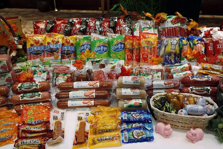 Some of the products made by WH Group Ltd. under Chinese brand names are displayed during an investment luncheon in Hong Kong on April 10, 2014. WH Group hopes to raise more than $5 billion in what would be the world's biggest initial public offering