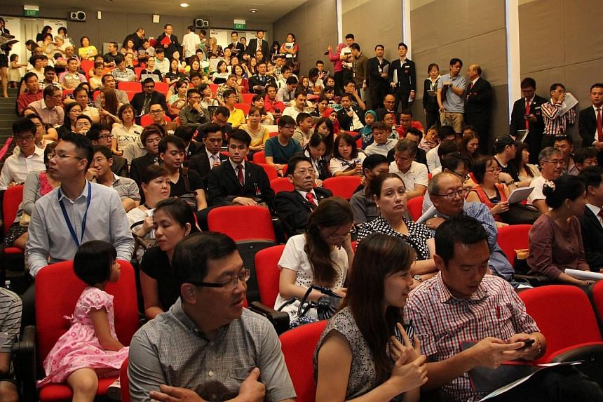 Photo shows large crowds balloting for units on April 5, 2014, at Puteri Cove Residences' launch at ERA's Headquarters in Toa Payoh.A luxury condominium in Malaysia's Iskandar region being built by Singaporean developers has met with strong dem