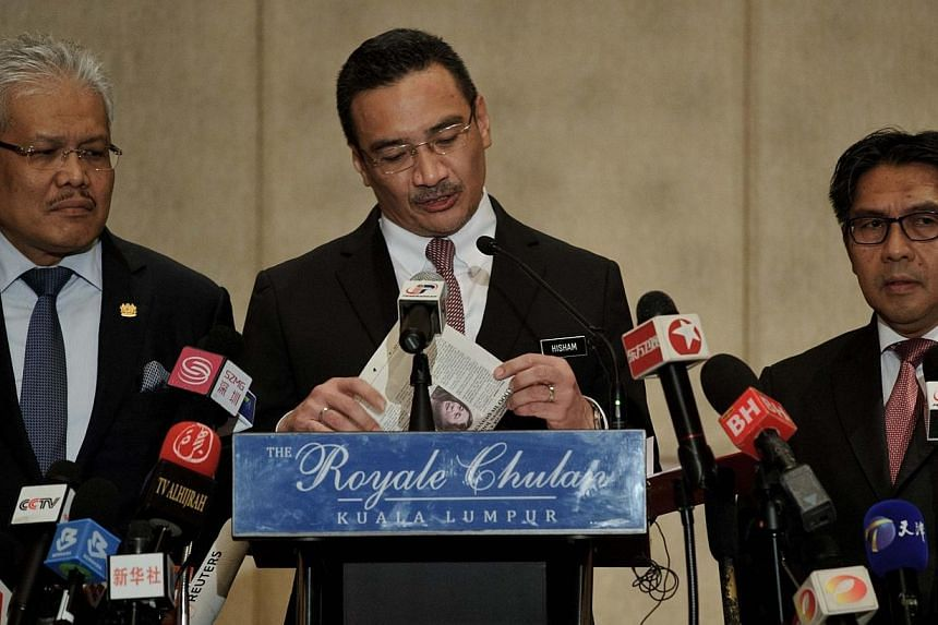 Malaysian Transport Minister Hishammuddin Hussein (Center) speaks during a press conference on the missing Malaysia Airlines flight MH370 in Kuala Lumpur on April 7, 2014.Military aircraft were not deployed to chase down Malaysia Airlines fligh