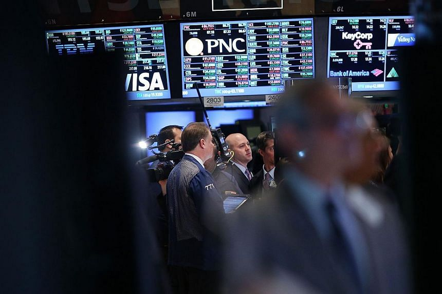 Traders work on the floor of the New York Stock Exchange after the ringing the Opening Bell on April 1, 2014 in New York City.The tech-rich Nasdaq Composite Index Thursday led US stocks sharply lower as anxiety about pricey technology equities