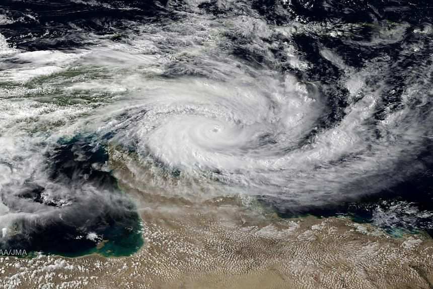 This satellite image obtained courtesy of the National Oceanic and Atmospheric Observatory (NOAA) shows Severe Tropical Cyclone along the far north Queensland Coast of Australia on April 10, 2014.A cyclone packing winds of up to 275 kilometres