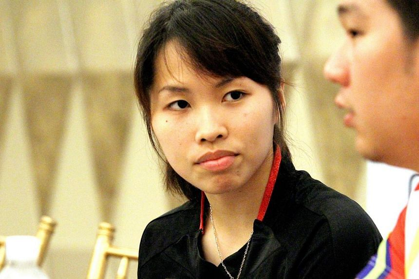 Thailand's women's singles world champion Ratchanok.Women's world champion badminton player Ratchanok Intanon was eliminated from the OUE Singapore Open on Friday, April 11, 2014, losing 14-21, 12-21 to China's Han Li in the quarter-finals. --
