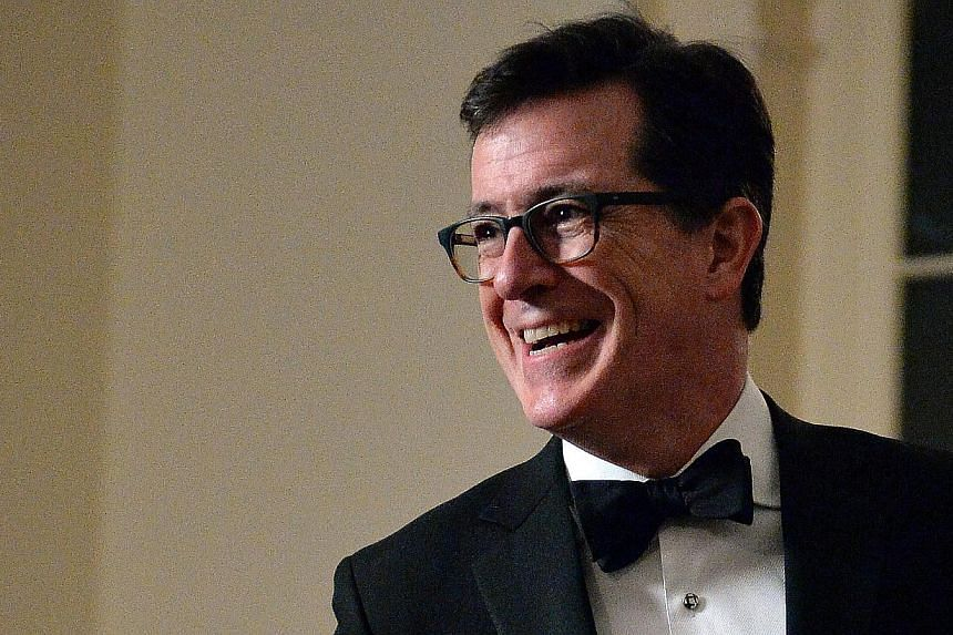 Comedian Stephen Colbert arrives at the White House in Washington, DC in this February 11, 2014 file photo. -- PHOTO: AFP