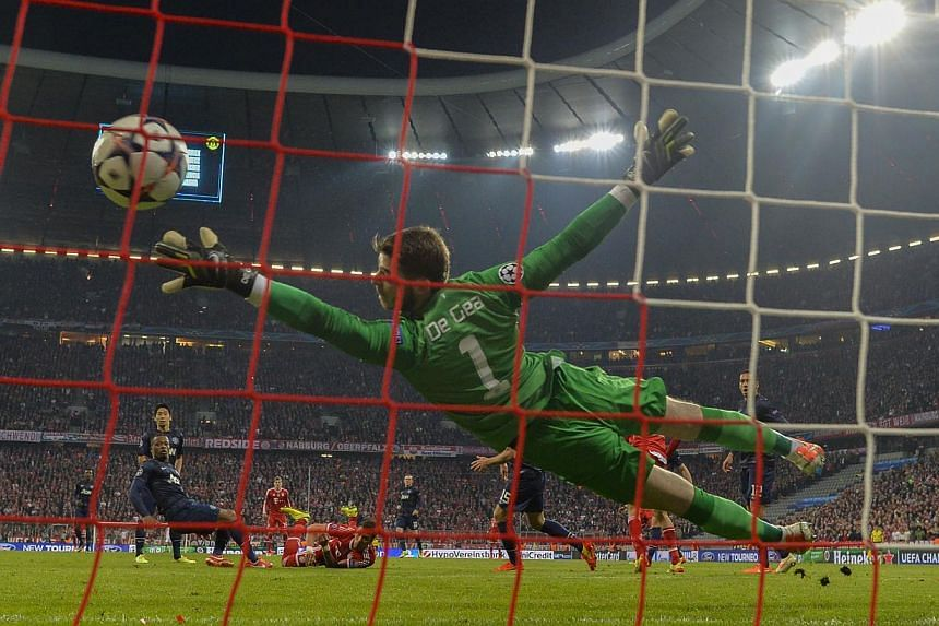 The Red Devils had a forgettable quarter-final second leg in Munich, with David de Gea failing to stop this shot from Bayern's Thomas Mueller. The Germans went on to win 3-1. -- PHOTO: AGENCE FRANCE-PRESSE