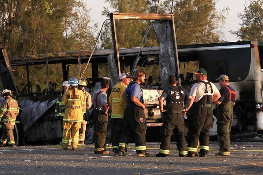 Rescue workers, police and firefighters survey the scene where a truck and a tour bus collided on Interstate 5 near Highway 32 near Orland, California on April 10, 2014. -- PHOTO: REUTERS