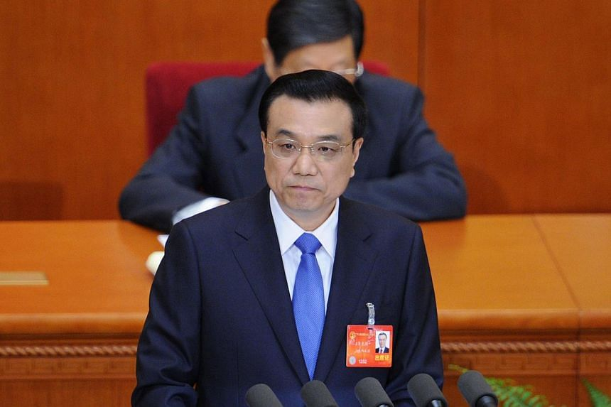 File photo of Chinese premier Li Keqiang when he delivered his report during the opening session of the 12th National People's Congress (NPC) in the Great Hall of the People in Beijing on March 5, 2014. -- PHOTO: AFP