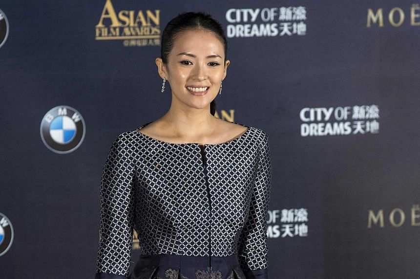 Chinese actress Zhang Ziyi poses on the red carpet at the Asian Film Awards in Macau on March 27, 2014. -- FILE PHOTO: REUTERS