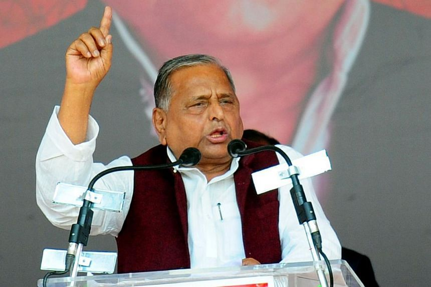 """In this photograph taken on March 2, 2014, Leader of India's Samajwadi Party Mulayam Singh Yadav gestures as he addresses a public rally """"Desh Banao Desh Bachao"""" at the Parade Grounds in Allahabad. The mother of a student who was fatally gang-raped o"""