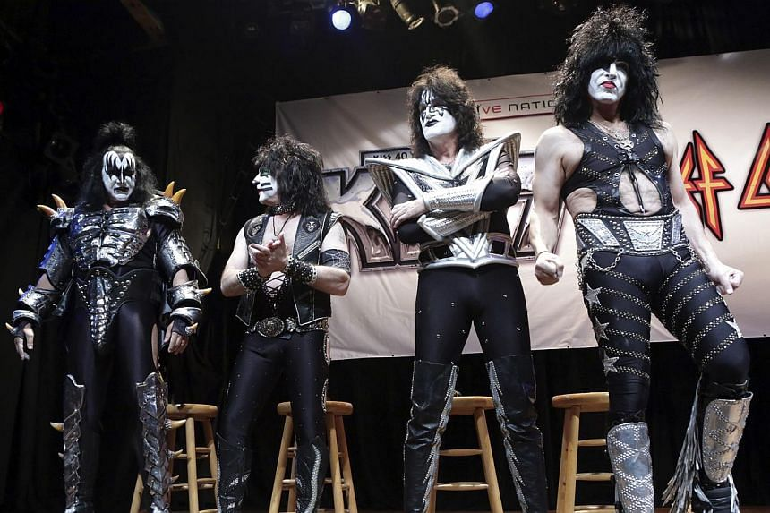 (From left) Gene Simmons, Eric Singer, Tommy Thayer and Paul Stanley of the rock band Kiss arrive on stage for an announcement that Kiss and Def Leppard will team up this summer for a 42-city North American tour, at the House of Blues in West Hollywo