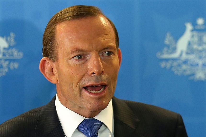 Australian Prime Minister Tony Abbott speaks during a press conference at RAAF Base Pearce in Bullsbrook, Western Australia on March 31, 2014. Mr Abbott said on April 11, 2014, he was very confident that signals detected in the search for missing Mal