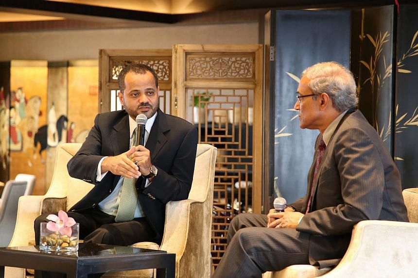 Oman's Secretary-General of the Ministry of Foreign Affairs, Mr Sayyid Badr Hamad Al-Busaidi,(left) fielding questions after his speech on Thursday to members of the Singapore Press Club, which was moderated by Mr Zainul Abidin, chairman of S