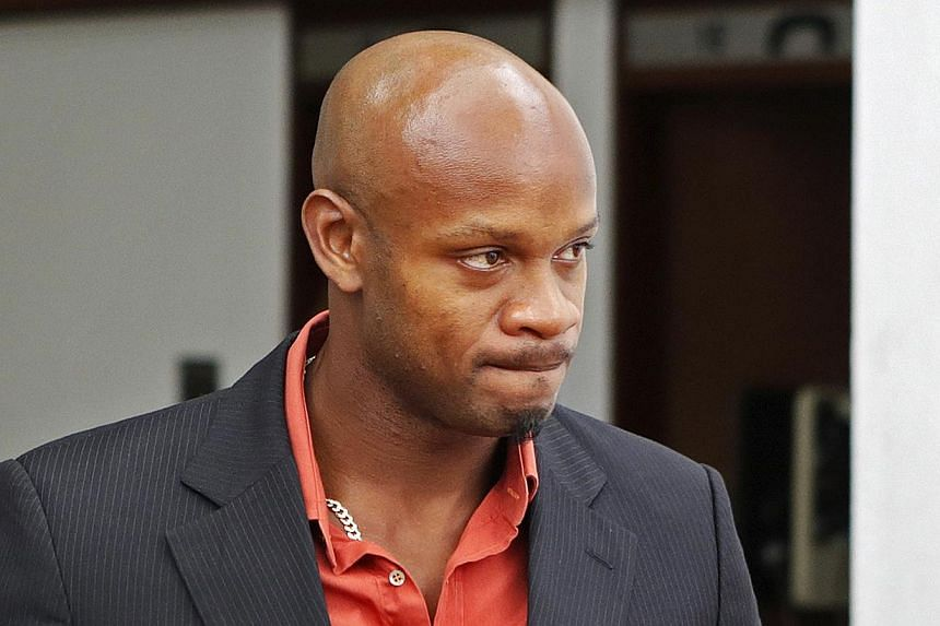 Jamaica's Olympic runner Asafa Powell, who tested positive for doping at the Jamaican Championships in 2013, takes a lunch break on the first day of his hearing before the country's anti-doping commission in Kingston on Jan 14, 2014. -- PHOTO: REUTER