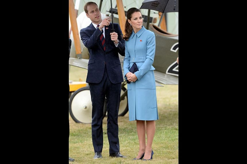 Britain's Catherine, the Duchess of Cambridge, and her husband Prince William watch a static WWI display at the Omaka Aviation Heritage Centre near Blenheim -- PHOTO: REUTERS