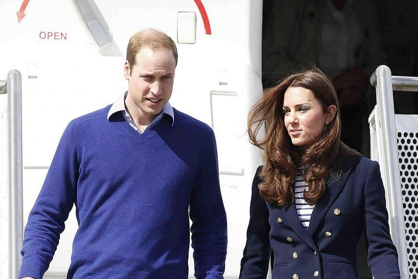 Britain's Prince William and his wife Catherine, the Duchess of Cambridge, arrive at the Whenuapai Airbase for a visit in Auckland April 11, 2014. -- PHOTO: REUTERS