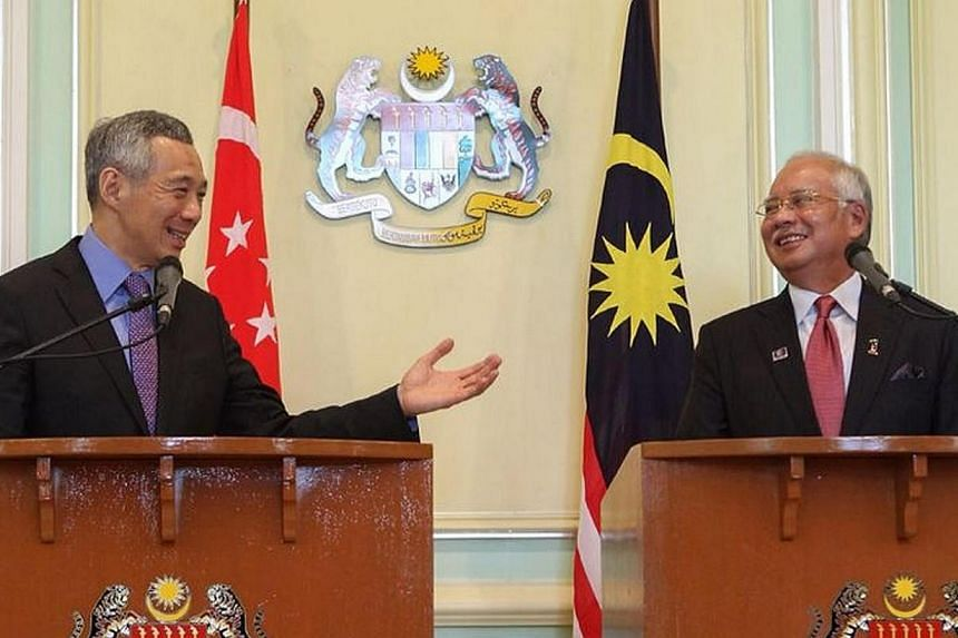 PM Lee Hsien Loong and PM Najib Razak wrap up the Malaysia-Singapore leaders' retreat in Putrajaya on April 7, 2014. The Land Transport Authority (LTA) has called for a tender for parties to study possible corridors for the Singapore leg of the