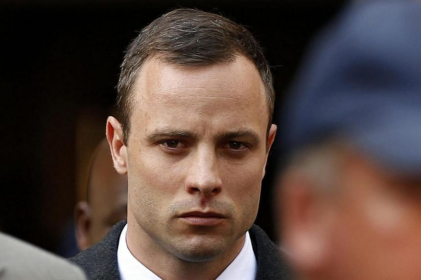Oscar Pistorius leaves after attending his trial at the high court in Pretoria on April 7, 2014. The judge in Paralympian Oscar Pistorius' murder trial on Thursday, April 10, 2014, told the prosecution to stop calling him a liar as Mr Gerrie Nel