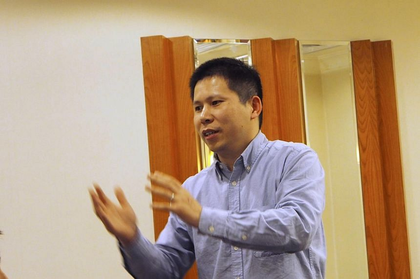 Chinese rights advocate Xu Zhiyong speaks during a meeting in Beijing on March, 30, 2013. A Chinese court on April 11, 2014 upheld a four-year jail sentence for Xu, who had campaigned for the education rights of children and for officials to disclose