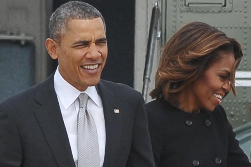 President Barack Obama and his wife Michelle reported half a million dollars in income for 2013, down from the previous year as revenues from his best-selling books continued to fall, according to their tax returns released by the White House on Frid