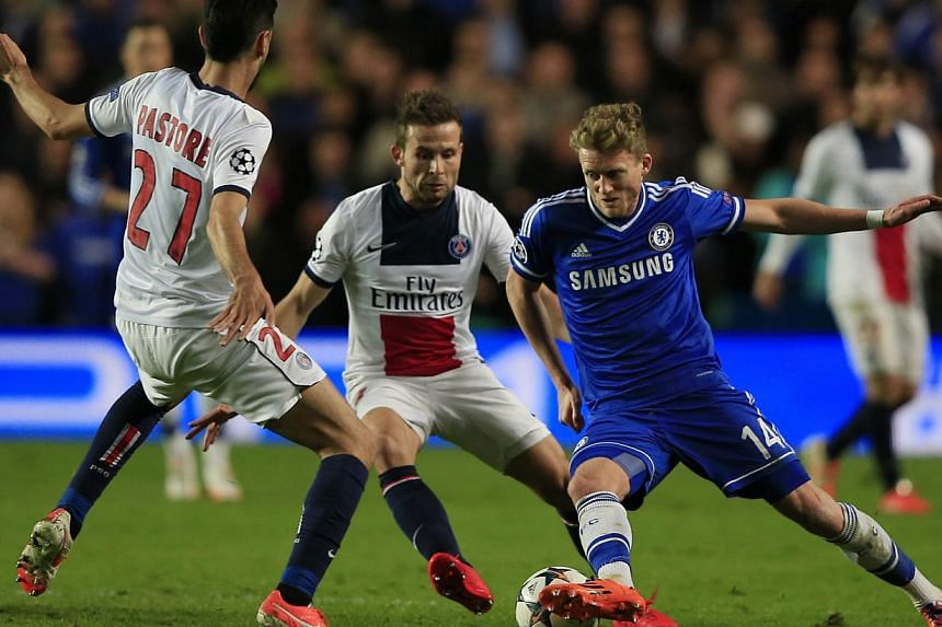 Chelsea's German striker Andre Schurrle (right) attempts to take on Paris' Argentinian midfielder Javier Pastore (left) during the UEFA Champions League quarter final second leg football match between Chelsea and Paris Saint-Germain at Stamford Bridg