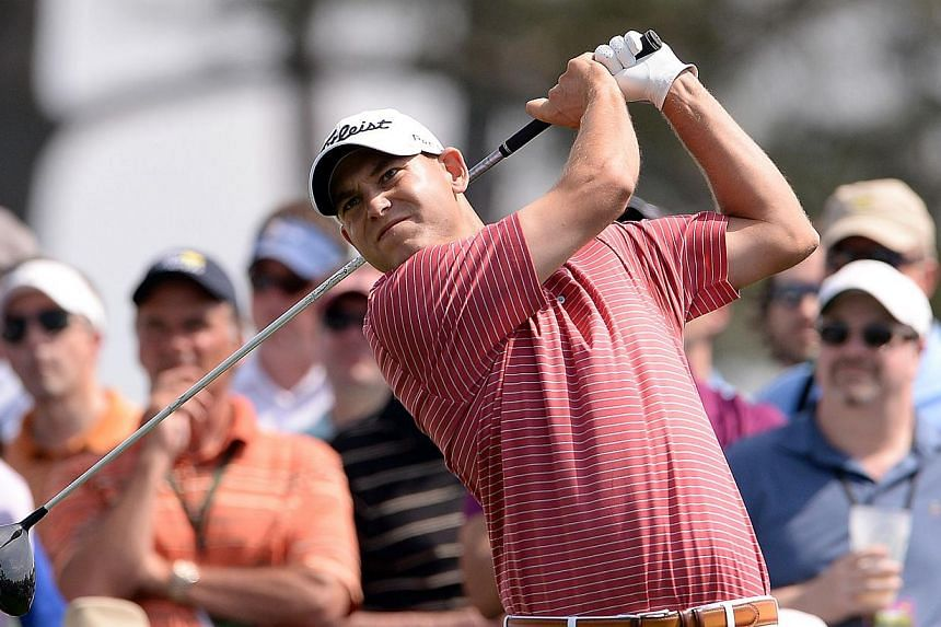 Bill Haas of the US plays a shot during the second round of the 78th Masters Golf Tournament at the Augusta National Golf Club on April 11, 2014 in Augusta, Georgia. Bubba Watson of the US ripped off five birdies in a row from the 12th hole to take a