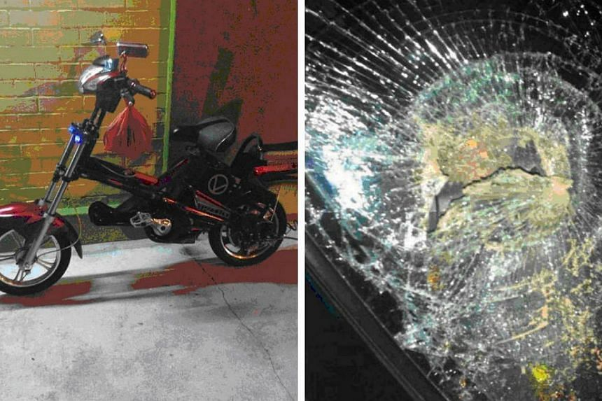 A total of $190 cash and a motorised bicycle (left) were seized from a couple after they were arrested. They are suspected of being involved in more than 20 thefts from vehicles, which involved smashed front windscreens and stolen cashcards. -- PHOTO