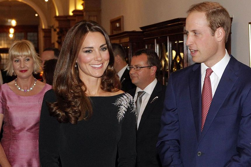 Britain's Prince William (right) and his wife Catherine, the Duchess of Cambridge (centre), attend an art unveiling ceremony at Government House in Wellington on April 10, 2014.The welcome awaiting the Duke and Duchess of Cambridge and their bo