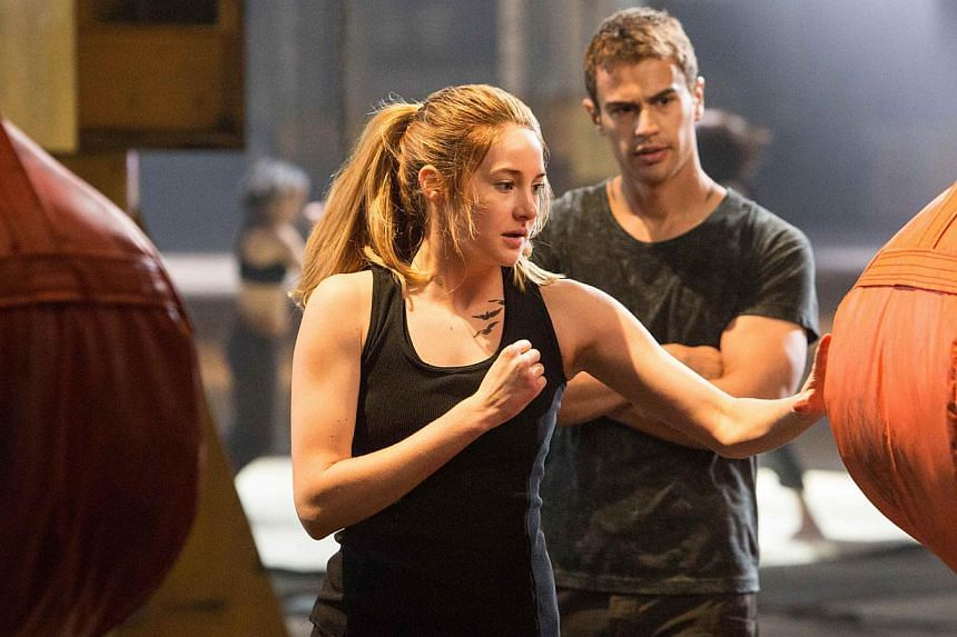 Divergent stars Shailene Woodley (left) and Theo James. -- PHOTO: GOLDEN VILLAGE PICTURES