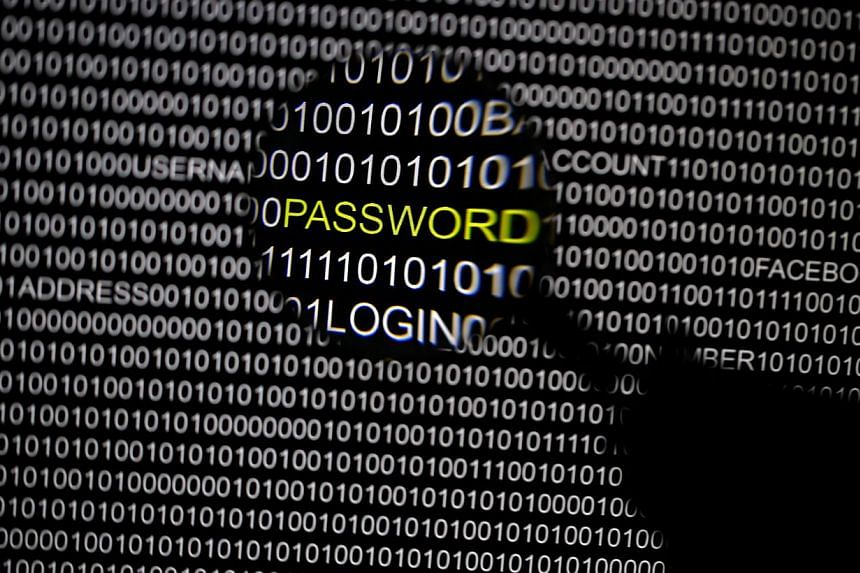 File picture illustration of the word 'password' pictured through a magnifying glass on a computer screen, taken in Berlin on May 21, 2013. -- FILE PHOTO: REUTERS