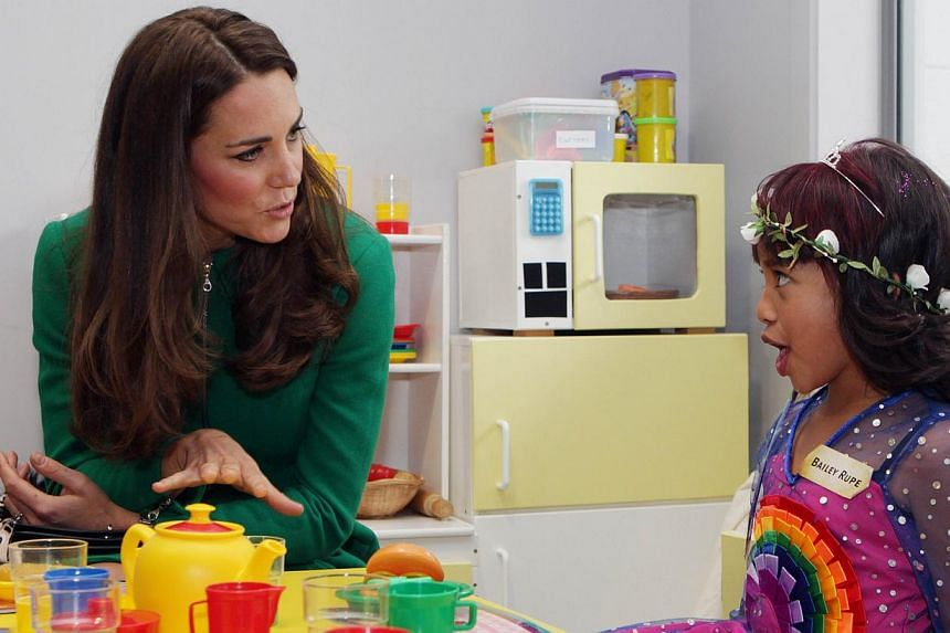 Britain's Duchess of Cambridge Catherine (left) speaks with Bailey Taylor during a visit to Waikato Hospice Rainbow Place in Waikato on April 12, 2014. -- PHOTO: AFP